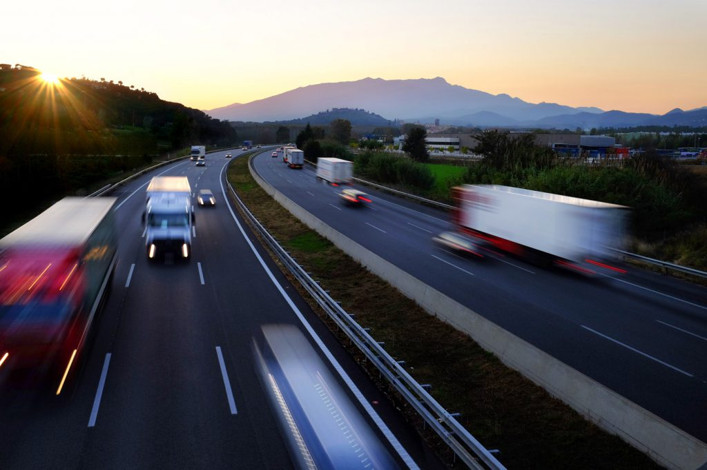 vehicles driving down the highway